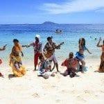 Langosta con un ministro en una playa de Isla Mauricio