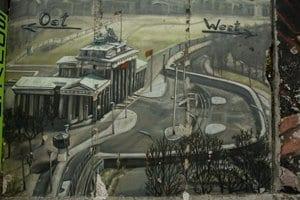 Dibujo del Berlin Este y Oeste en el muro