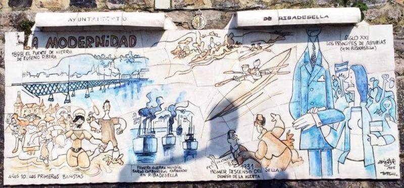 Mural sonre las piraguas pintado por Mingote en Ribadesella