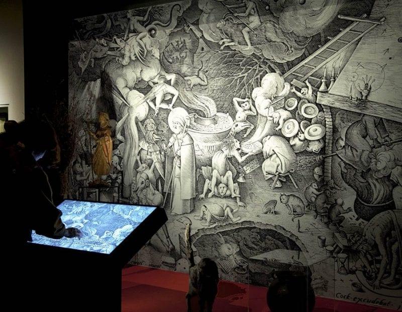 Grabado de Pieter Bruegel el Viejo donde se ven brujas volando en escobas por primera vez