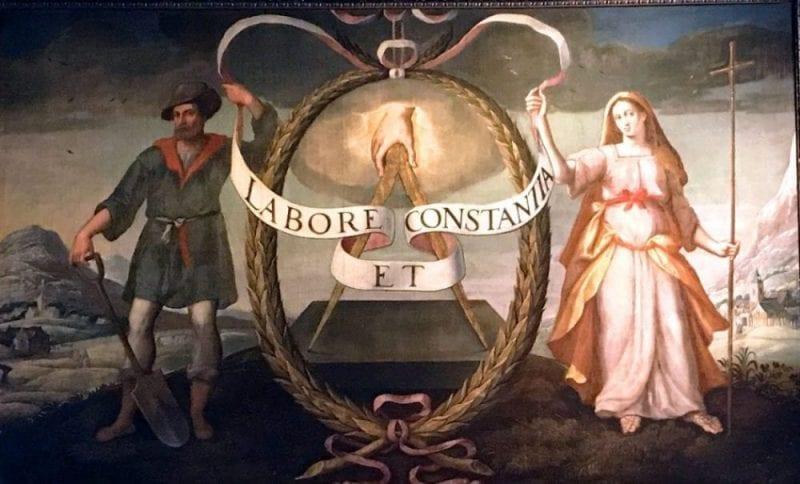 El lema y el logo de Plantino, un compás semi abierto