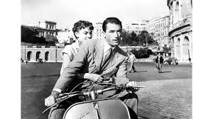 """Escena de """"Vacaciones en Roma"""" con una vespa"""